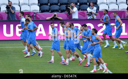 Players of team France warm-up during a training session of the French national soccer team at Donbass Arena in - Stock Photo