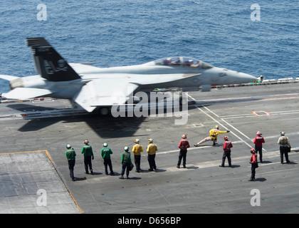 A US Navy F/A-18C Hornet launches from the flight deck of aircraft carrier USS Dwight D. Eisenhower April 9, 201 - Stock Photo