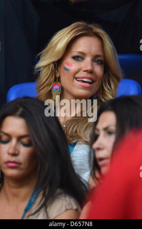 Sylvie van der Vaart, wife of dutch football player Rafael van der Vaart smiles in the stands prior to the UEFA - Stock Photo