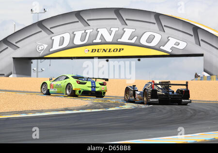 Racing cars steer up to the Dunlop bridge during the 80th 24 Hours Race of Le Mans on the Circuit de la Sarthe in - Stock Photo