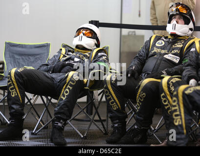 Mechanics of Lotus are resting in the pit during the 80th 24 Hours Race of Le Mans on the Circuit de la Sarthe in - Stock Photo