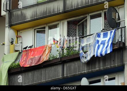German and Greek flags hang from a balcony of the Pallasseum on Pallasstrasse in Berlin-Schoeneberg, Germany, 19 - Stock Photo