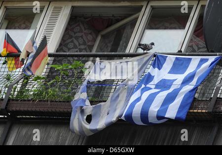 German and Greek flags hang from a balcony pf the Pallaseum on Pallasstrasse in Berlin-Schoeneberg, Germany, 19 - Stock Photo