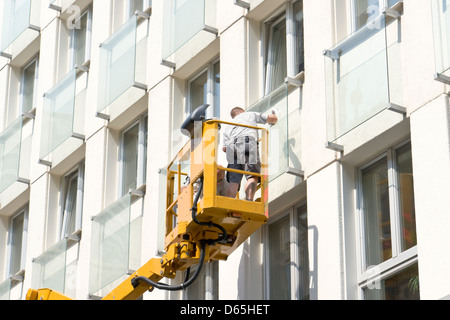 Window cleaner on aerial platform - Stock Photo
