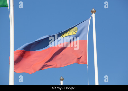 The flag of Liechtenstein fluttering in the breeze. - Stock Photo