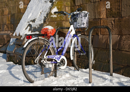 Bike parked in a bike rack in winter York North Yorkshire England UK United Kingdom GB Great Britain - Stock Photo