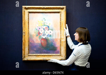 London, UK. 12th April 2013. Sotheby's employee poses in front of Odilon Redon 'Vase d'anemones' (Est. $1,2-1,5 - Stock Photo