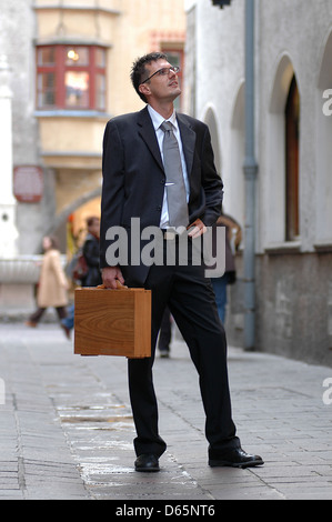 suit,business travel,self confident,businessman - Stock Photo