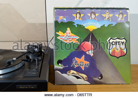Record player with LPs and the Bay City Rollers album Once Upon a Star, England - Stock Photo