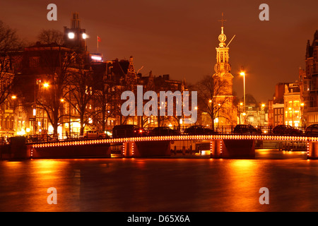 Amsterdam by night with the Munt tower in the Netherlands - Stock Photo