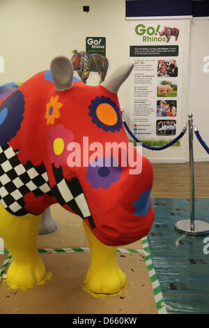 Southampton, UK. 12th April 2013 - Go! Rhinos sculptures coming to life in the public painting space in Marlands - Stock Photo