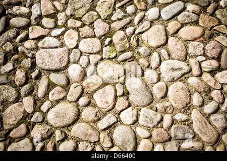 Detail of a medieval street from coarse pebbles - Stock Photo