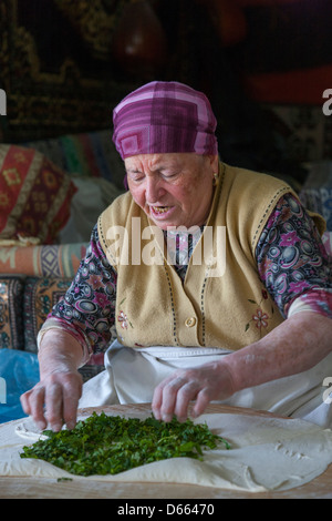 Making Turkish pancakes (crepes) near Selçuk in Turkey - Stock Photo