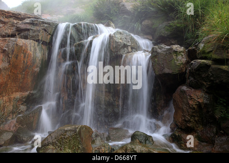 Falls on a thermal stream - Stock Photo