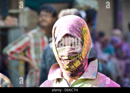 Boy on holi day playing at holigate mathura - Stock Photo