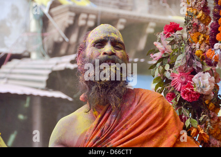 Hindu priest playing holi - Stock Photo