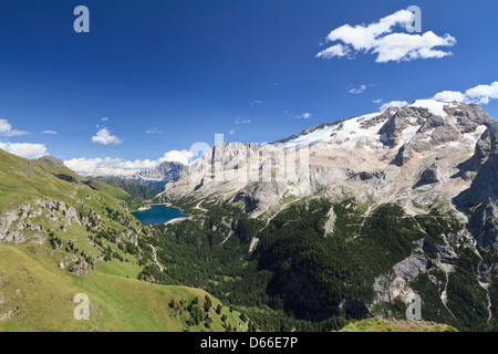 summer view of mount Marmolada and Fedaia lake, Trentino, Italy - Stock Photo