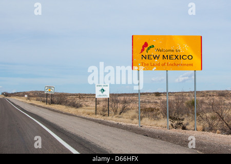 A bullet laden sign on the Pecos Hwy marking the border of New Mexico from Texas - Stock Photo