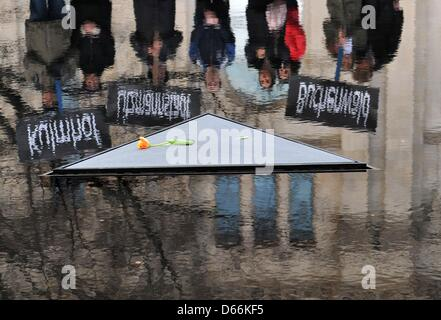 People present signs with the names of former National Socialist concentration camps at the Memorial to the Murdered - Stock Photo