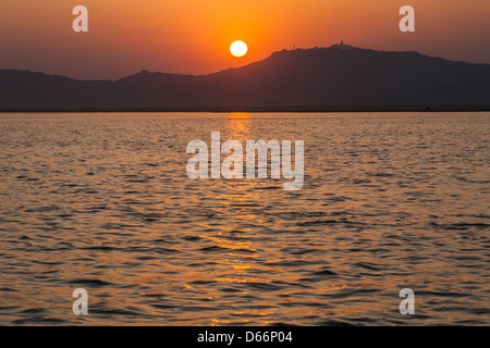 Sunset on the Irrawaddy River, Bagan, Myanmar, (Burma) - Stock Photo