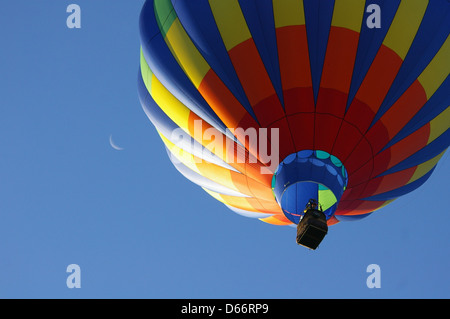 Spirit of Boise Hot Air Balloon Festival. Early morning launch of Hot Air Balloons with a sliver of the moon in - Stock Photo
