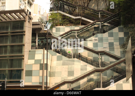 Lift, escalator and steps link King's Road and Fortress Hill MTR station with the Fortress Garden residential development - Stock Photo