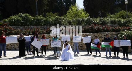 April 14, 2013 - Jerusalem, Jerusalem, Palestinian Territory - An Israeli Arab young woman wears a bridal gown as - Stock Photo