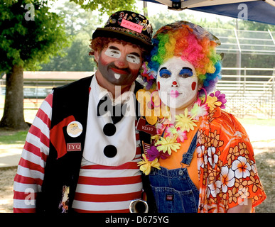 Man and woman clown portraits. - Stock Photo