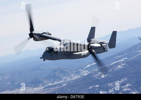 An MV-22B Osprey from Marine Medium Tiltrotor Squadron 165 flies near San Diego, Calif., Feb. 14, 2013. The purpose - Stock Photo