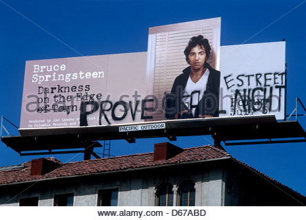 Bruce Springsteen billboard with graffitii on the Sunset Strip in Los Angeles, California - Stock Photo