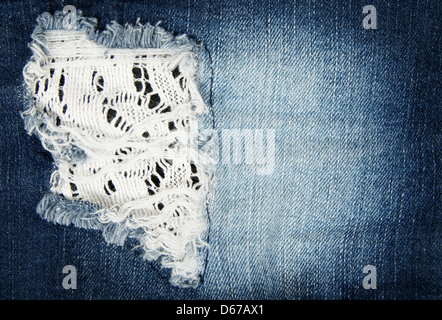Worn out blue denim fabric. Close-up of old jeans. - Stock Photo