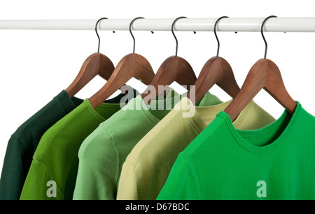 Choice of casual shirts on hangers, different tones of green. Isolated on white. - Stock Photo