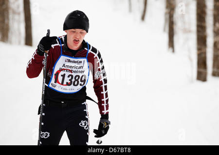 A skier on the trail between Cable and Hayward, Wisconsin competes in the American Birkebeiner classic event competition. - Stock Photo