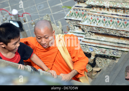 Buddhist monk and boy in temple, Thailand, Southeast Asia - Stock Photo