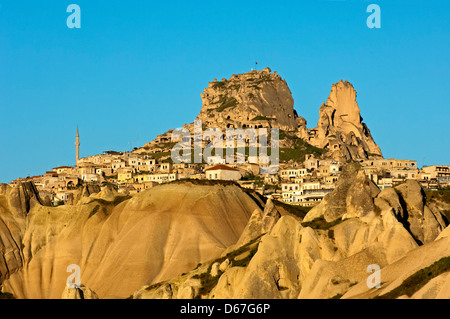 Castle Rock and the town of Uchisar in the morning sun, Cappadocia, central Anatolia, Turkey - Stock Photo
