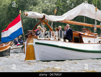 Dutch Queen Beatrix at the helm of her yacht Green Draeck during the celebrations of the 100th anniversary of the - Stock Photo