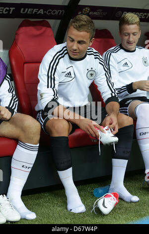 Germany's player Mario Goetze sits on the bench during the UEFA EURO 2012 semi-final soccer match Germany vs. Italy - Stock Photo