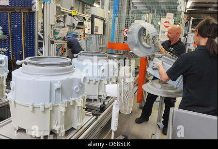 Workers of Bosch Siemens Hausgeraete GmbH assemble washing