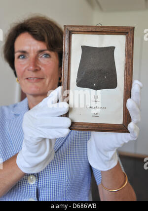 Curator Karin Stober presents a piece of the robe of Czech priest, philosopher and reformer Jan Hus's robe in the - Stock Photo