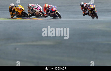 German rider Sandro Cortese of Team Red Bull KTM leads the Moto3 race ahead of French rider Alexis Masbou, Spanish - Stock Photo