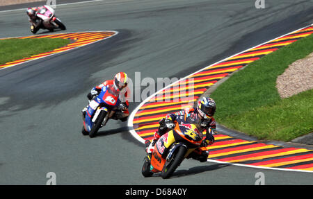 German rider Sandro Cortese of Team Red Bull KTM leads the Moto3 race ahead of French rider Alexis Masbou and Spanish - Stock Photo