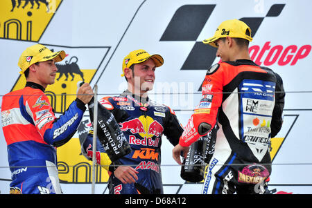 German rider Sandro Cortese of Team Red Bull KTM (C) wins the Moto3 race with French rider Alexis Masbou (L) and - Stock Photo