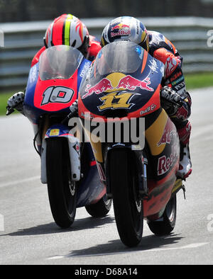 German rider Sandro Cortese of Team Red Bull KTM leads the field in the the Moto3 race ahead of French rider Alexis - Stock Photo