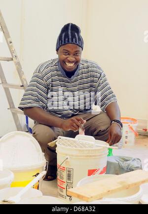 Abduorahmane Seck from Senegal smiles in the new school room at Karl Schubert School, Free Waldorf School, in Leipzig,Germany, - Stock Photo