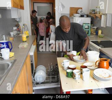 Abduorahmane Seck from Senegal works in the kitchen at Karl Schubert School, Free Waldorf School, in Leipzig,Germany, - Stock Photo