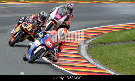 French MotoGP rider Alexis Masbou of Team Caretta Technology leads the field ahead of German rider Sandro Cortese - Stock Photo