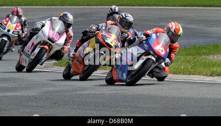 (L to R) French MotoGP rider Alexis Masbou of Team Caretta Technology leads the field ahead of German rider Sandro - Stock Photo
