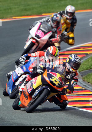 German rider Sandro Cortese of Team Red Bull KTM leads the field ahead of French MotoGP rider Alexis Masbou of Team - Stock Photo