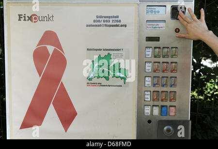 Drug addicts can anonymously and at any time buy sterile syringes at a syringe vending machine of the Fixpunkt e.V. - Stock Photo