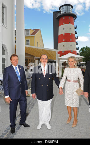 Managing director Roland Mack (L), British actor Sir Roger Moore and his wife Kristina Tholstrup pose for the photographers - Stock Photo